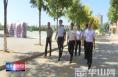 王小平调研全区教育工作并看望慰问优秀教师和困难教师代表